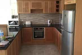 Oak look kitchen including appliances