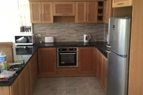 Oak look kitchen including appliances