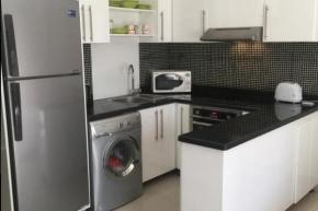 White laminate kitchen including appliances